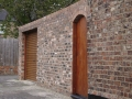 New wall arch and wooden gates.